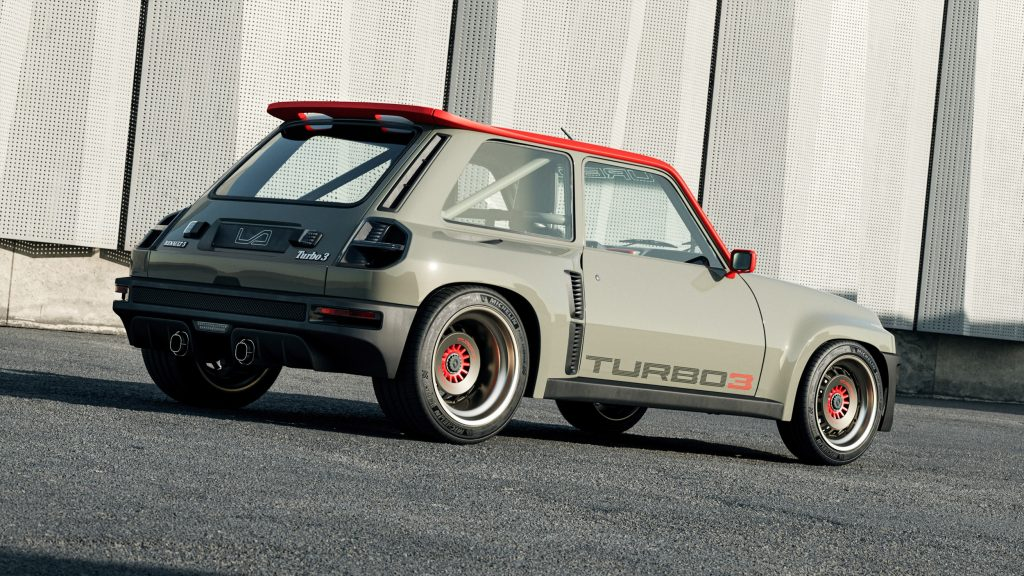The rear 3/4 view of a green-red-and-black Legende Automobiles Turbo 3 parked amongst shipping containers