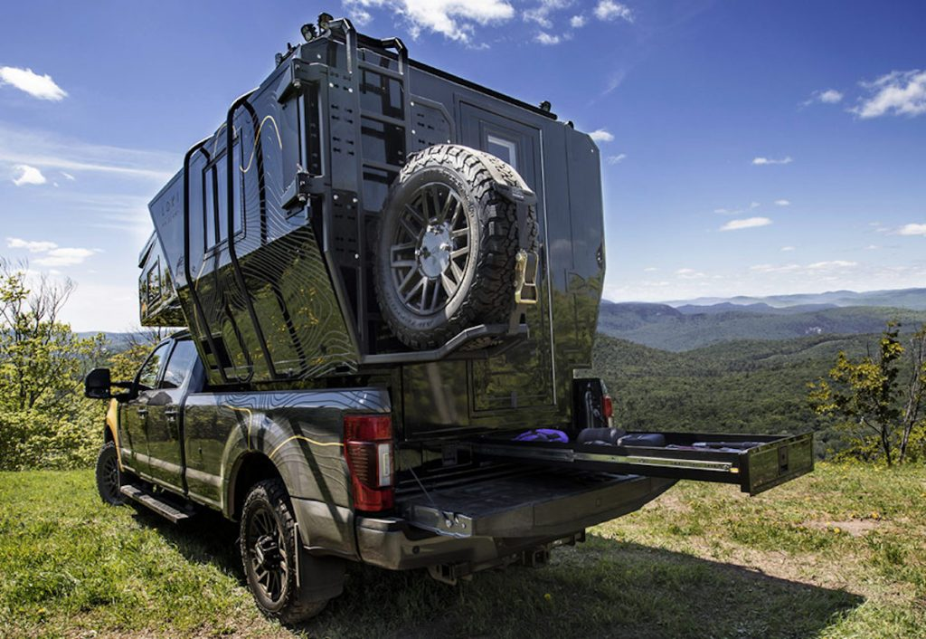 Loki Falcon truck camper top from behind parked in the mountains
