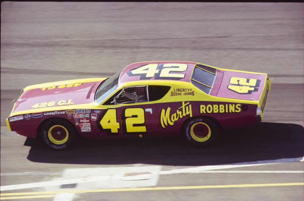 Marty Robbins drives a Dodge Charger to an eighth place finish at the 1972 Miller 500.