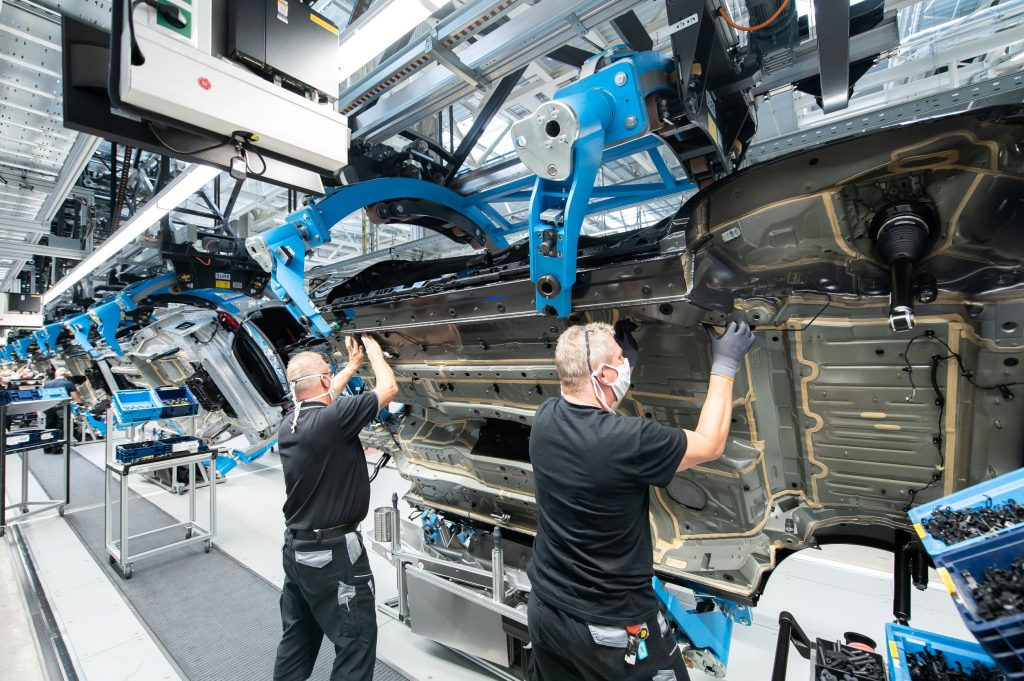 Mercedes-Benz employees install brake lines in a 2021 S-Class