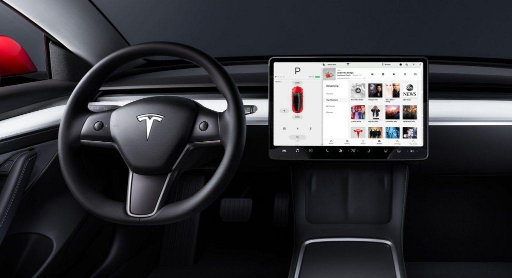 The steering wheel and screen inside a Tesla Model 3.