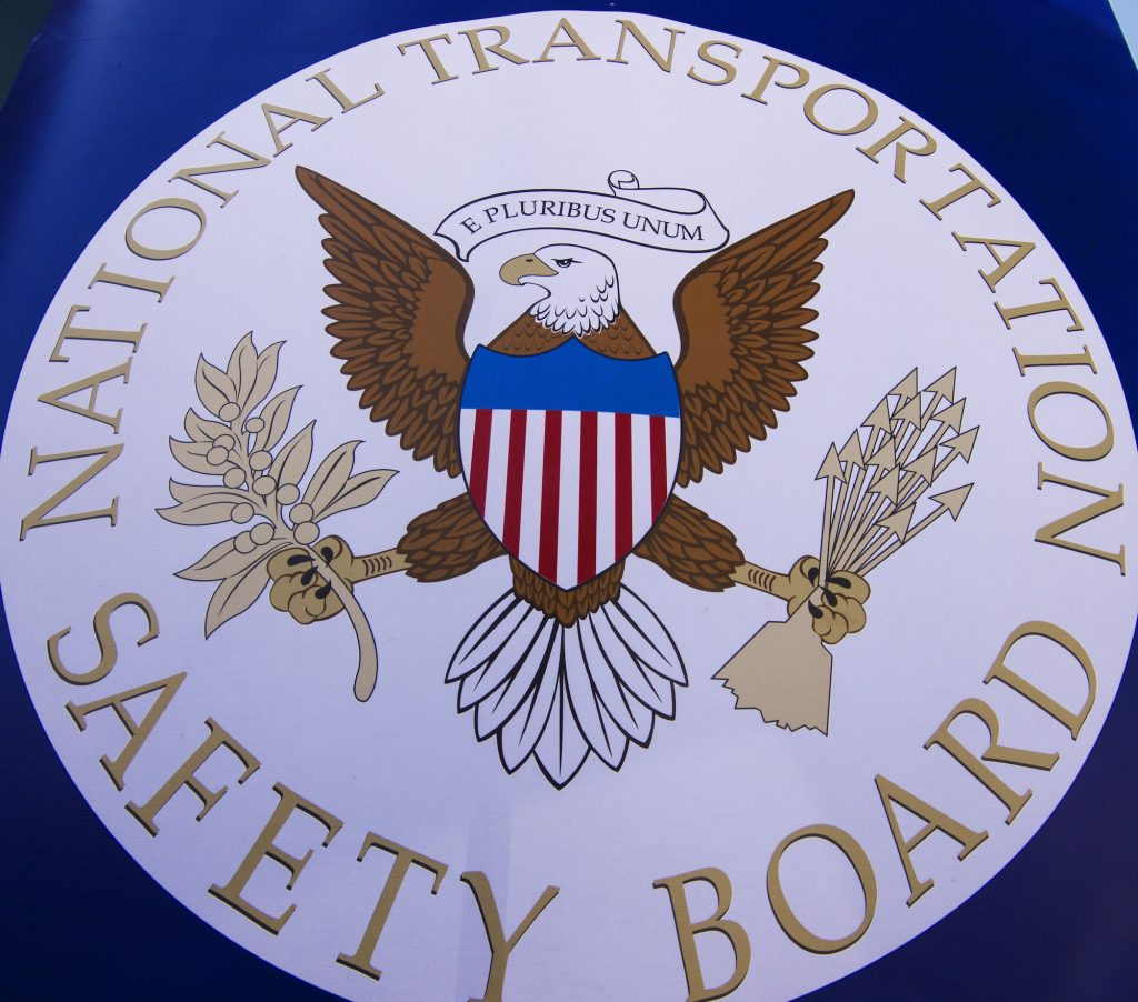 The NTSB seal is seen during a safety event at Trailside Middle School, in Ashburn, Virginia, in August 2015