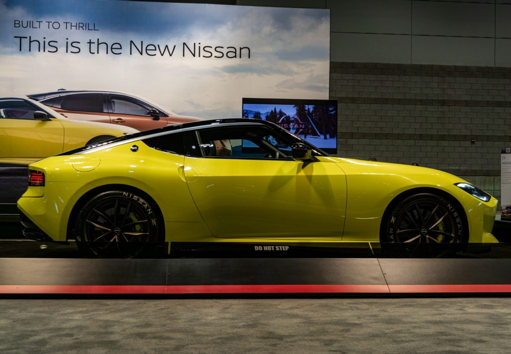 The side view of the yellow Nissan Z Proto Concept at the 2021 Chicago Auto Show