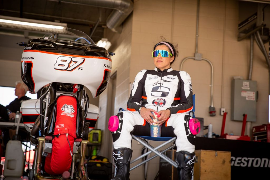 Patricia Fernandez in sunglasses sitting next to her Saddlemen King of the Baggers Indian Challenger