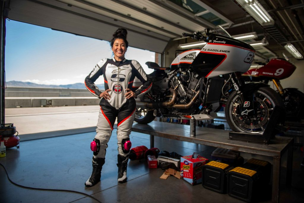 Patricia Fernandez with her Saddlemen King of the Baggers Indian Challenger in a track-side garage