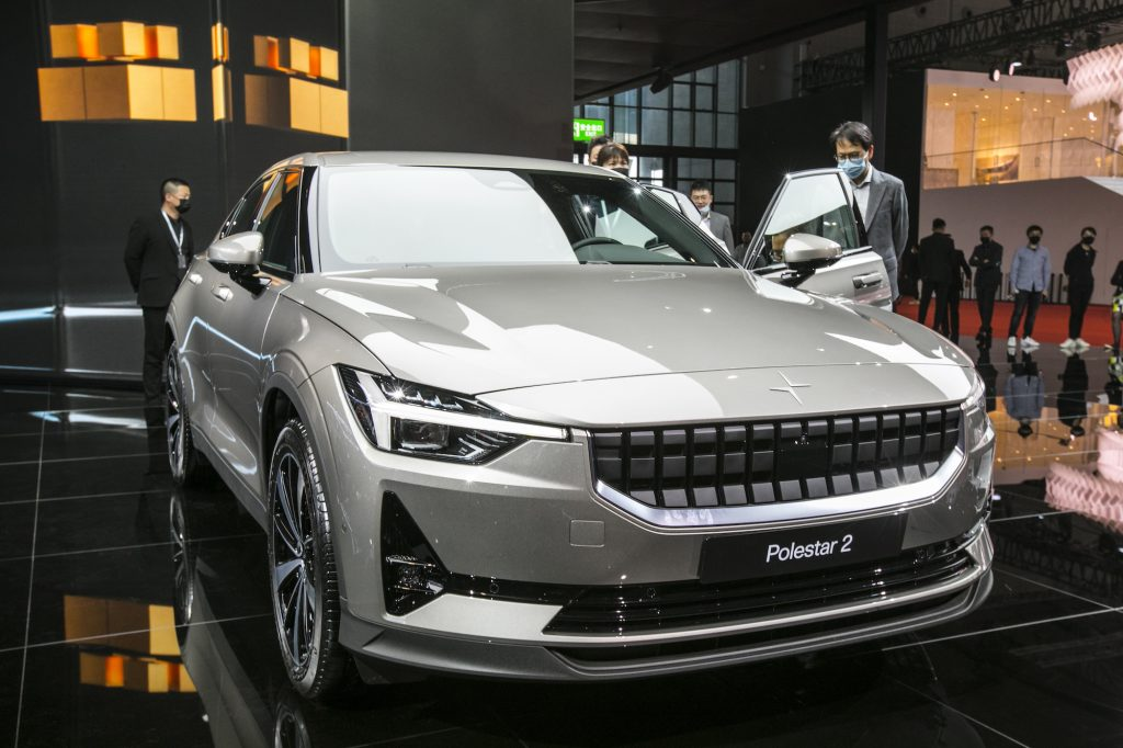 Visitors look at a Polestar 2 electric car during Auto Shanghai in April 2021 in Shanghai, China
