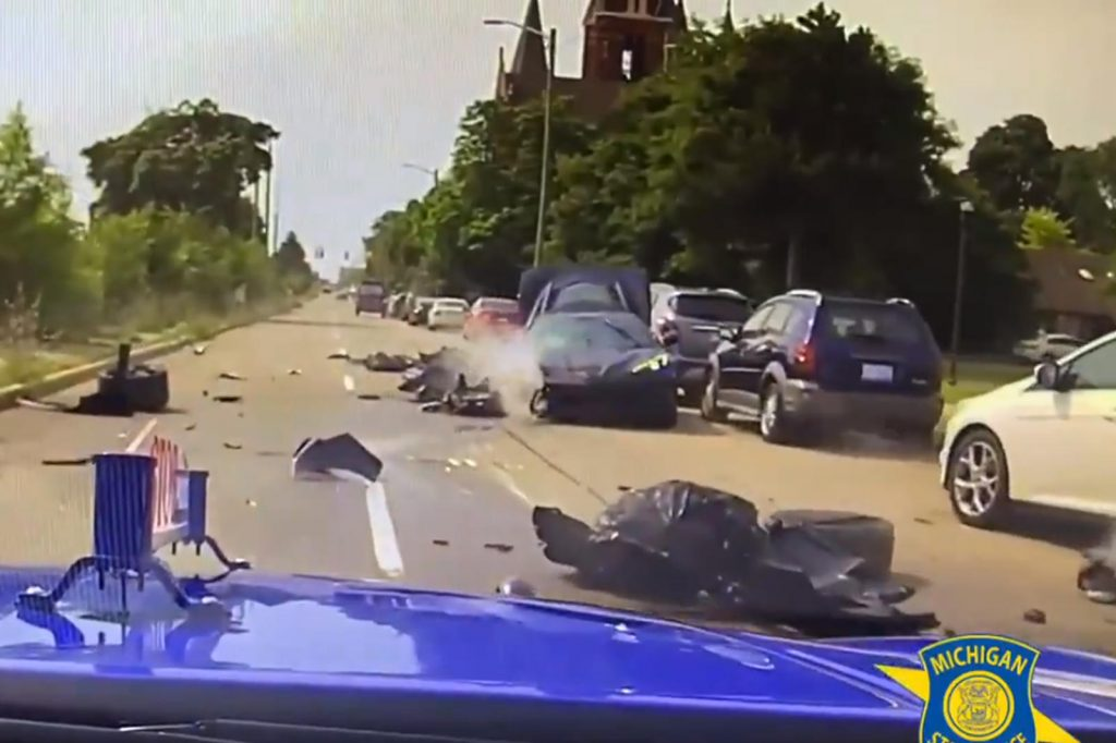 dash cam shot of Police chase of 2021 C8 Corvette in accident