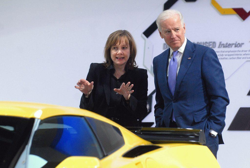President Joe Biden and GM CEO Mary Barra looking at yellow Corvette