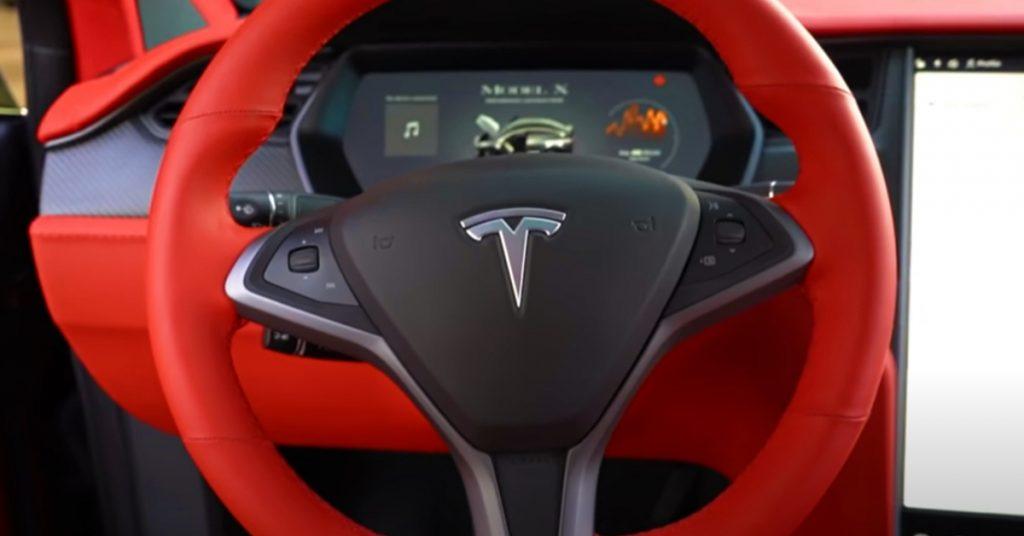 The interior of Quavo's custom red Tesla Model X.