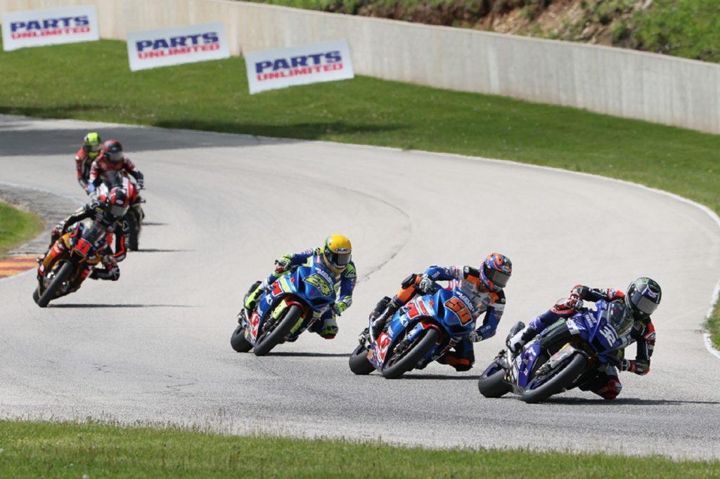 Racers in a MotoAmerica HONOS Superbike race