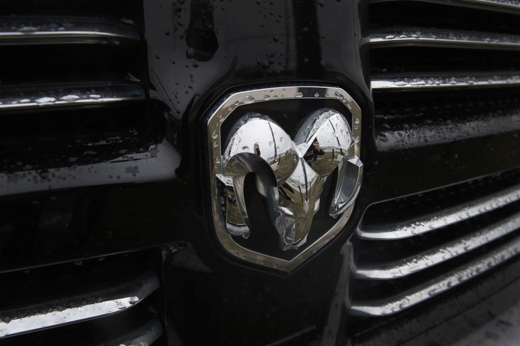 A Ram logo embedded on the grille of a pickup truck