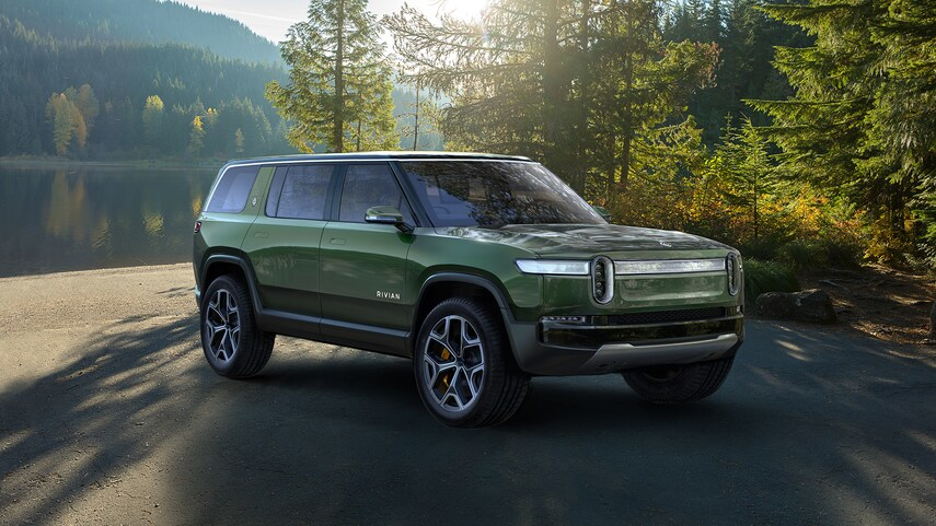 A green 2021 Rivian R1S parked in a driveway