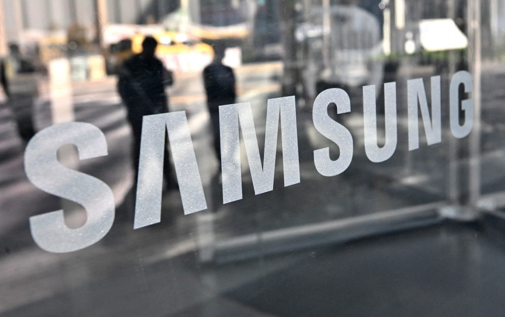 The Samsung logo on a window of a retail store