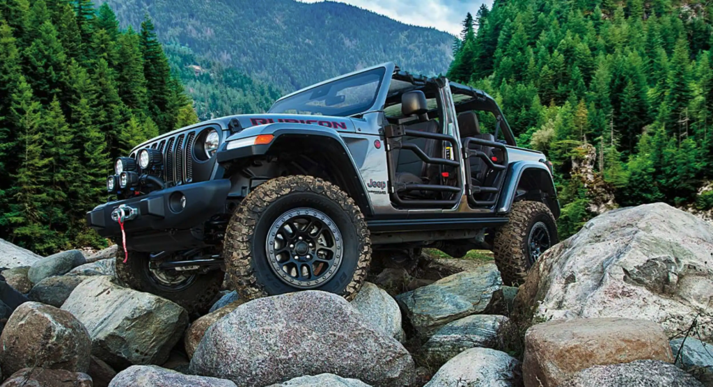 The 2021 Jeep Wrangler 4xe crawling over rocks