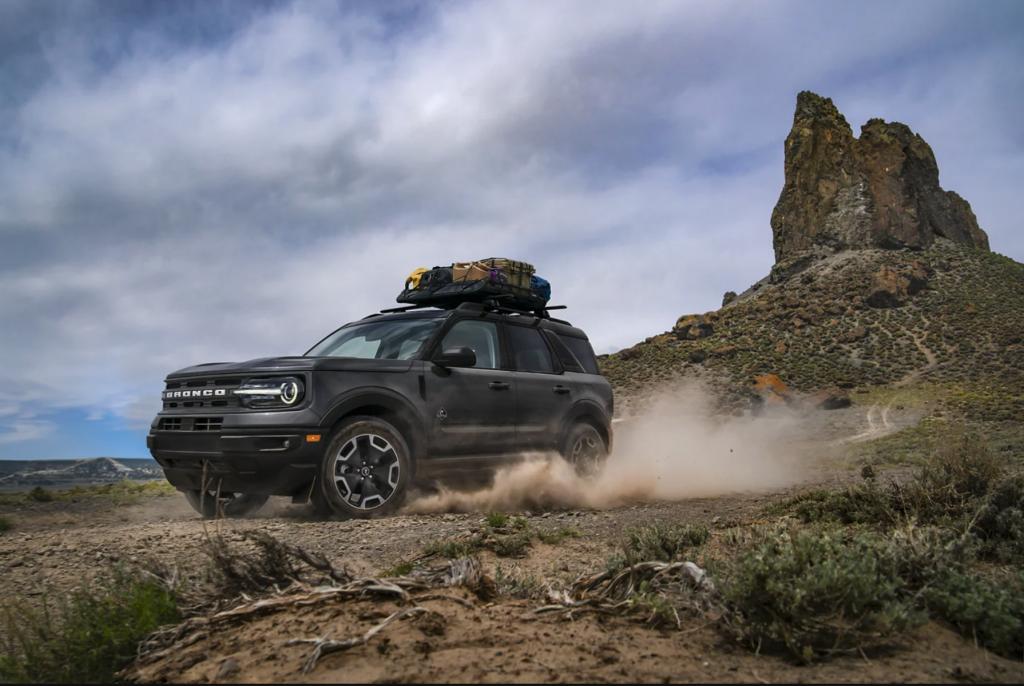 A black 2021 Ford Bronco Sport kicking up dirt
