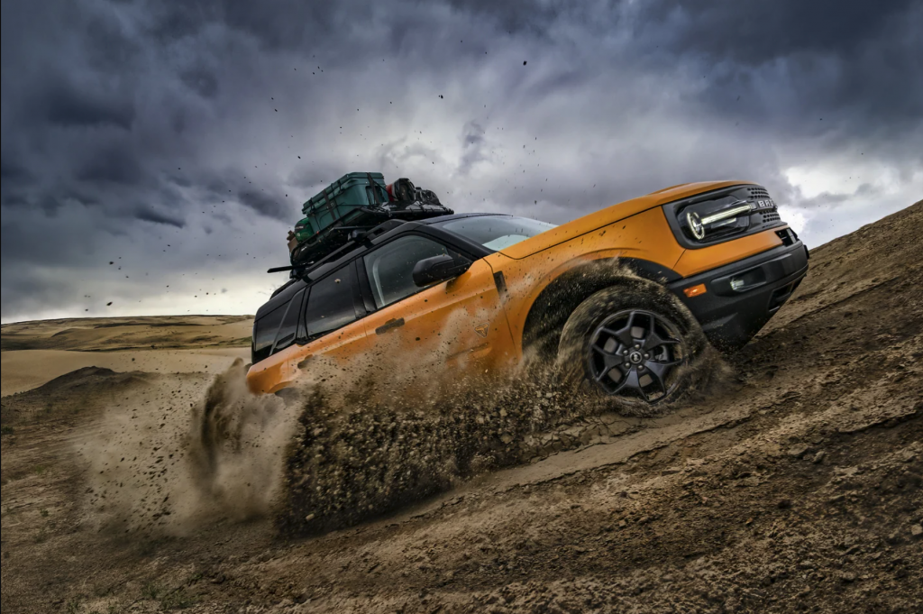 A yellow 2021 Ford Bronco Sport kicking up dirt