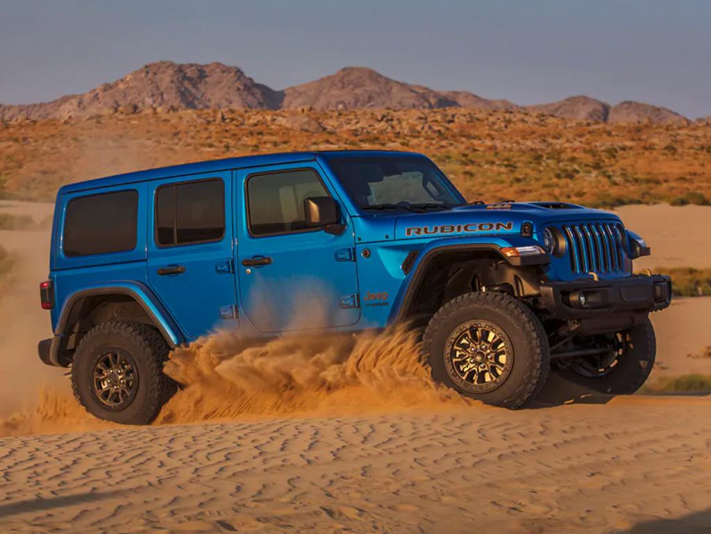 A blue 2021 Jeep Wrangler Rubicon 392 kicking up sand