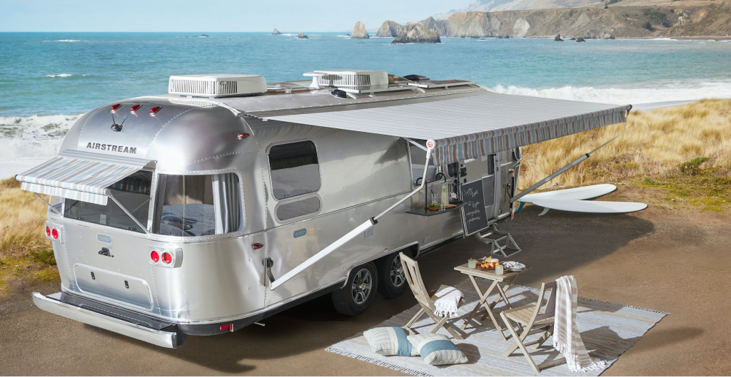 The Airstream Pottery Barn Travel Trailer parked near the beach
