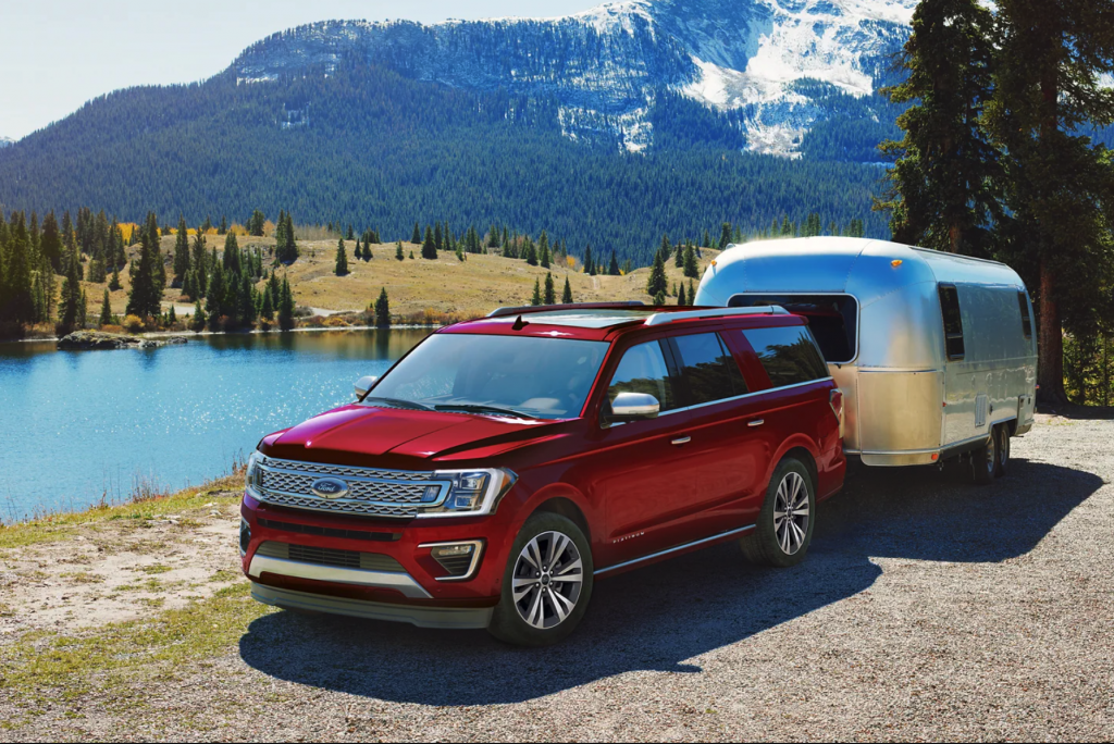 A red 2021 Ford Expedition towing an Airstream trailer shows of one of the best SUVs for cargo space.