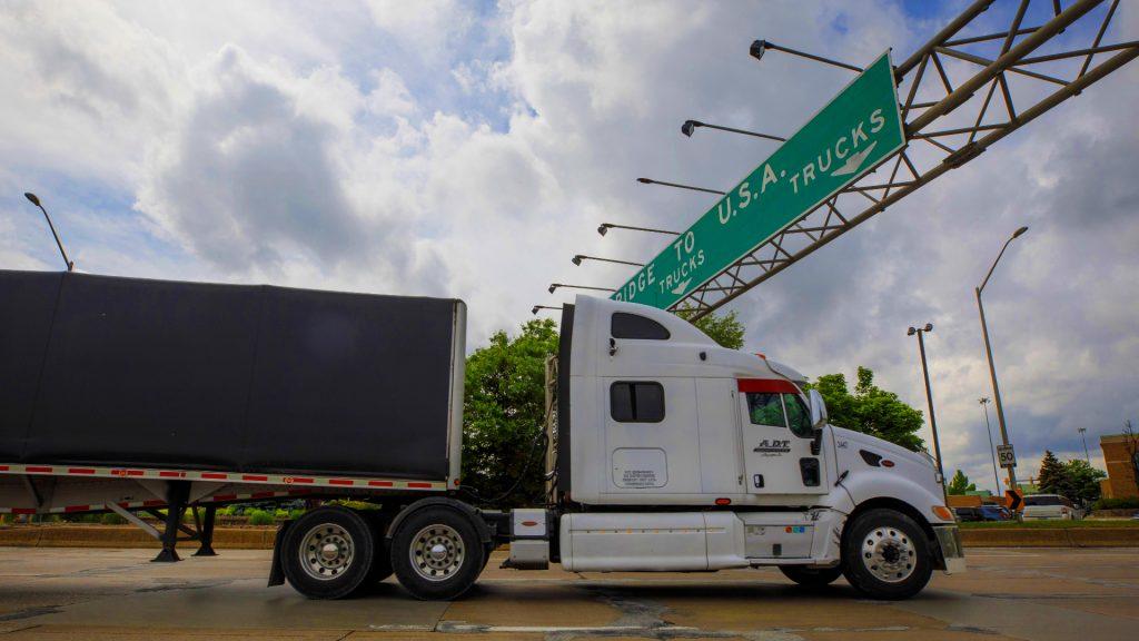 A trucks enters a line to cross the Ambassador Bridge into Detroit, Michigan.