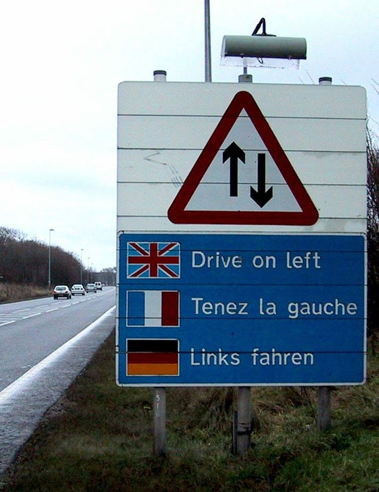 sign telling European drivers to drive on the left side of the road in the U.K. in case they have left-hand drive American cars