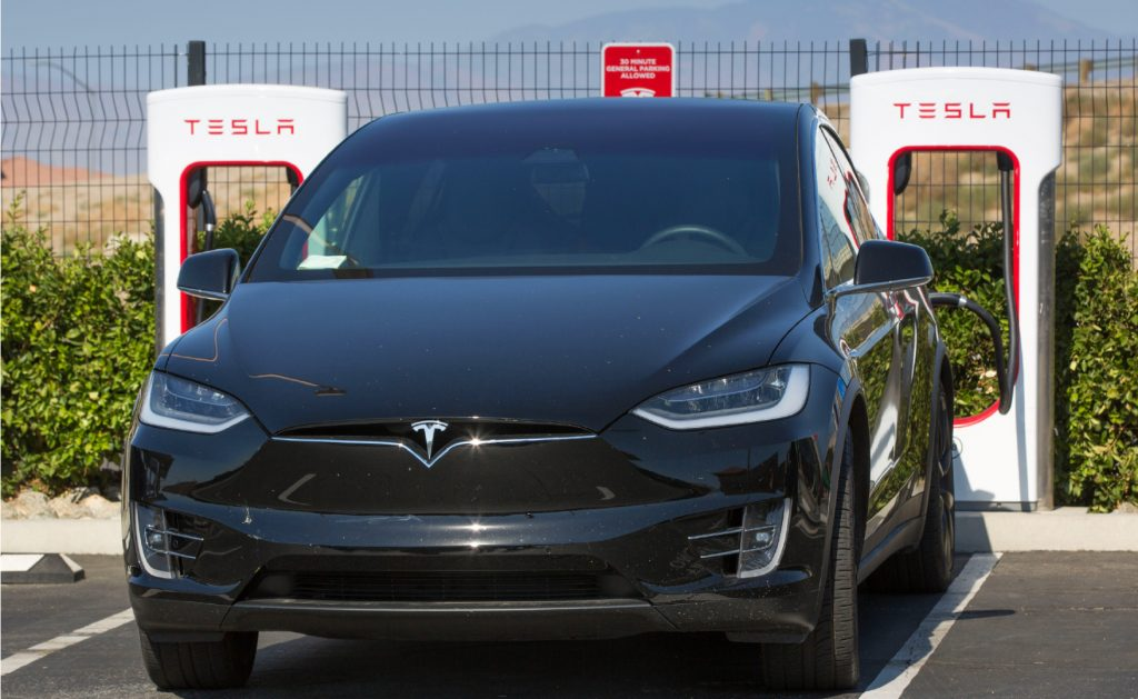 A Tesla electric vehicle supercharging station near the Tejon Ranch Outlet Stores in the Tehachapi Mountains, adjacent to Interstate 5, is viewed on July 7, 2021, near Lebec, California.