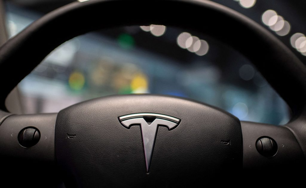 The inside of a Tesla car Model 3 is seen at a Tesla shop inside of a shopping Mall in Beijing on May 26, 2021.