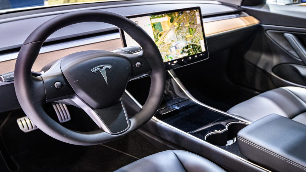 Tesla Model 3 compact full electric car interior with a large touch screen on the dashboard on display at Brussels Expo.