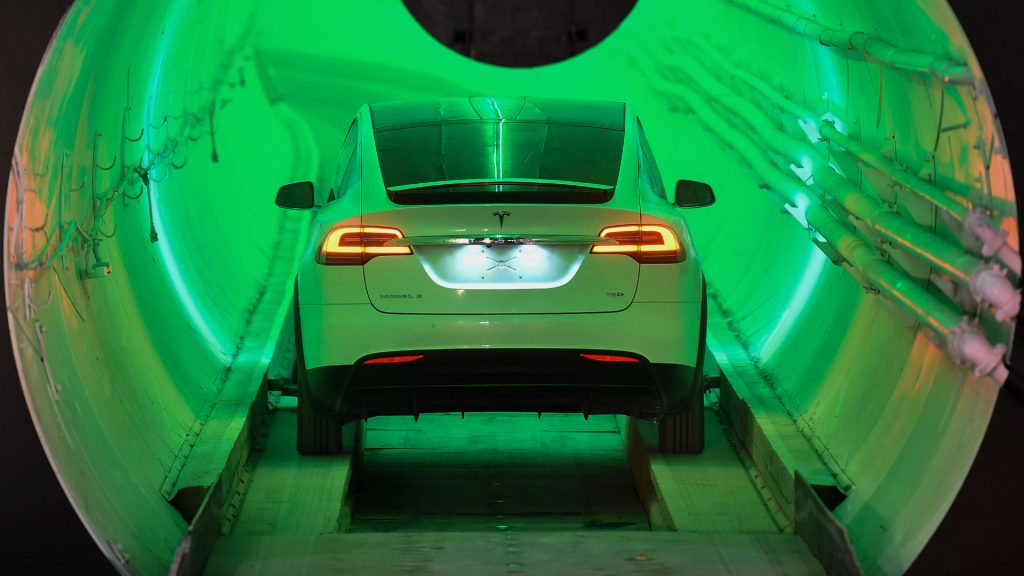 A modified Tesla Model X enters a tunnel before an unveiling event for The Boring Company.