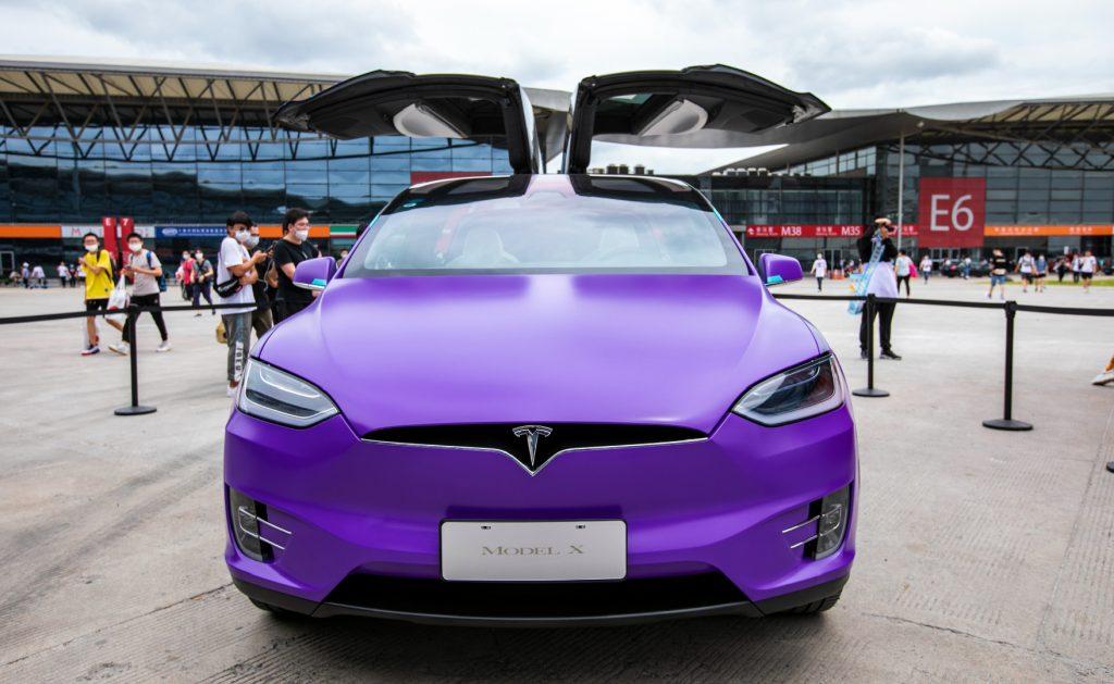 A purple Tesla Model X.