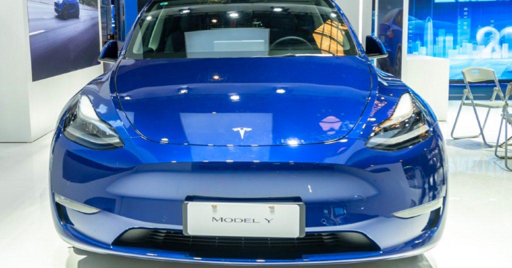 A blue Tesla Model Y electric SUV.