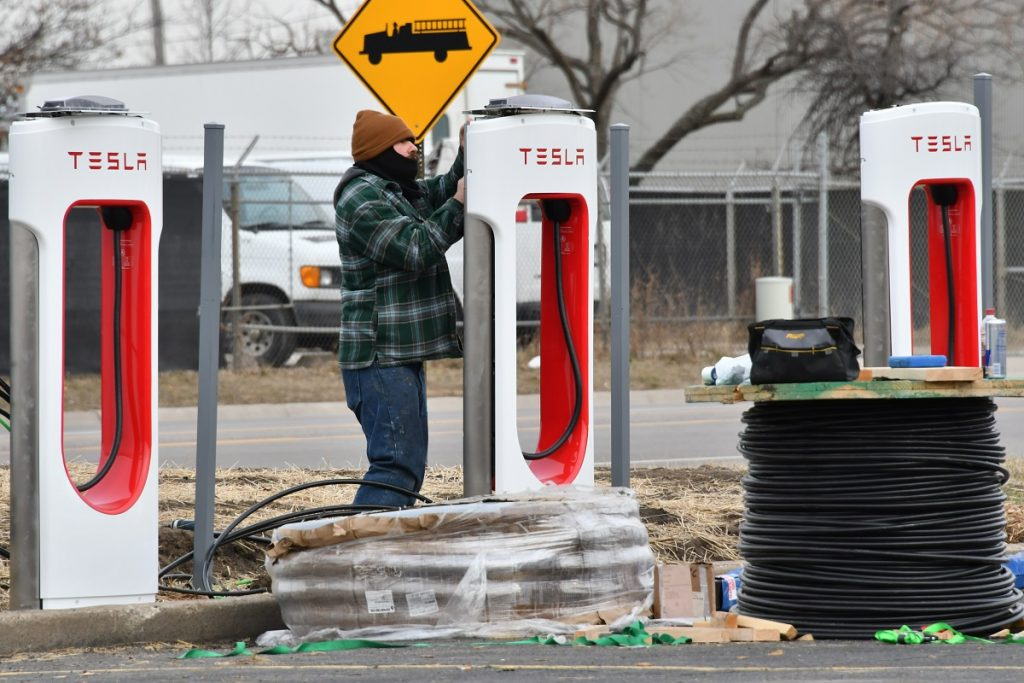 A Tesla Supercharger being installed.