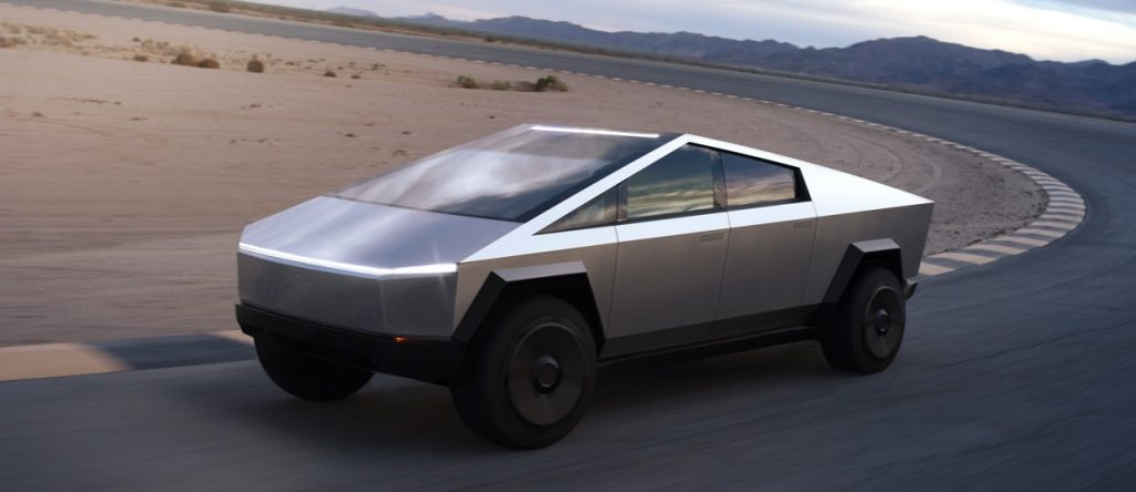 The 2021 Tesla Cybertruck driving down the road