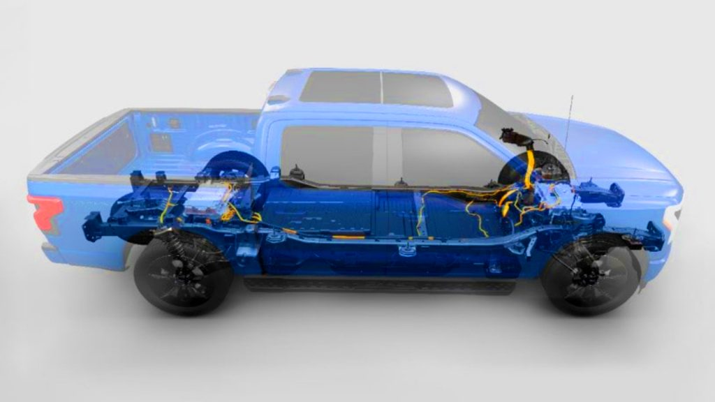 The powertrain of a blue Ford F-150 Lightning.