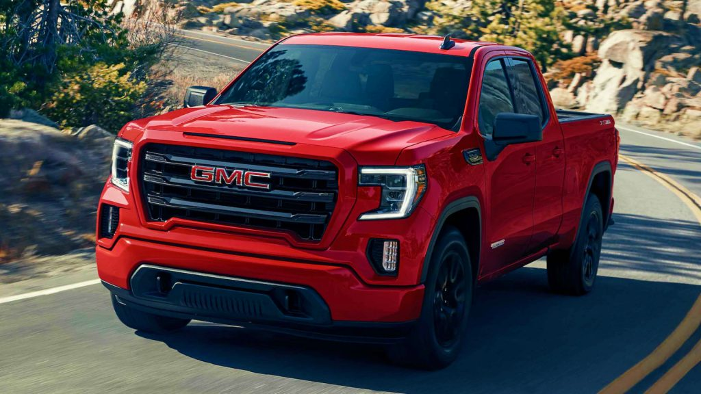A red GMC Sierra 1500 pickup truck.
