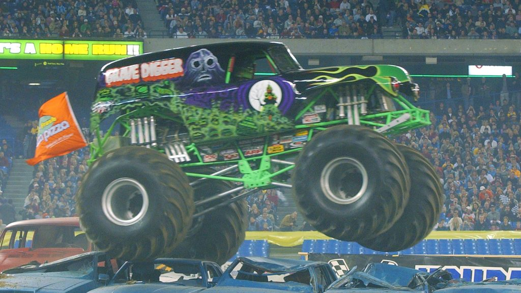 The Grave Digger monster truck crushing cars.
