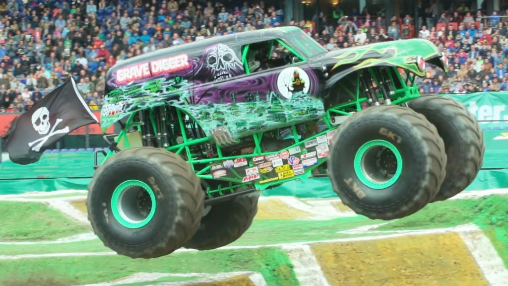 The Grave Digger flying over a dirt mound in front of the 50,000 strong crowd in Rotterdam, July 2016.