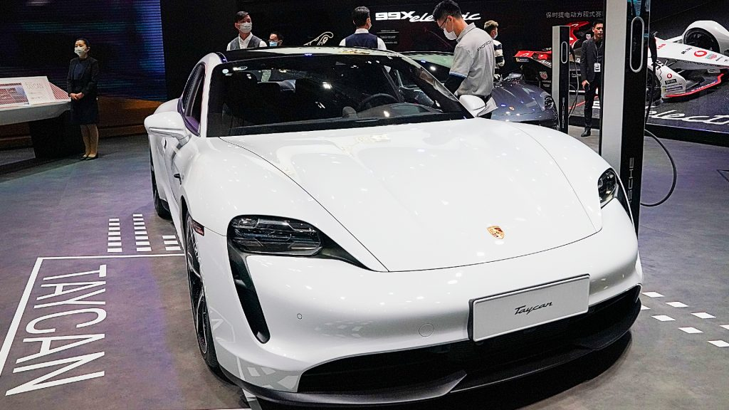 A white Porsche Taycan car is displayed during the 19th Shanghai International Automobile Industry Exhibition, also known as Auto Shanghai 2021, at National Exhibition and Convention Center.