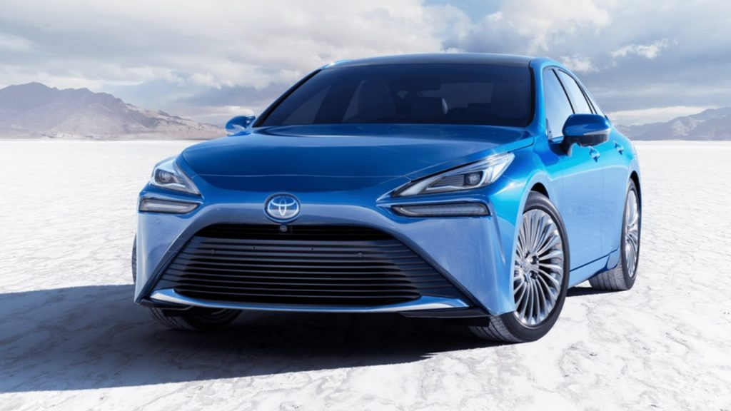 A blue 2021 Toyota Mirai hydrogen fuel cell electric vehicle.