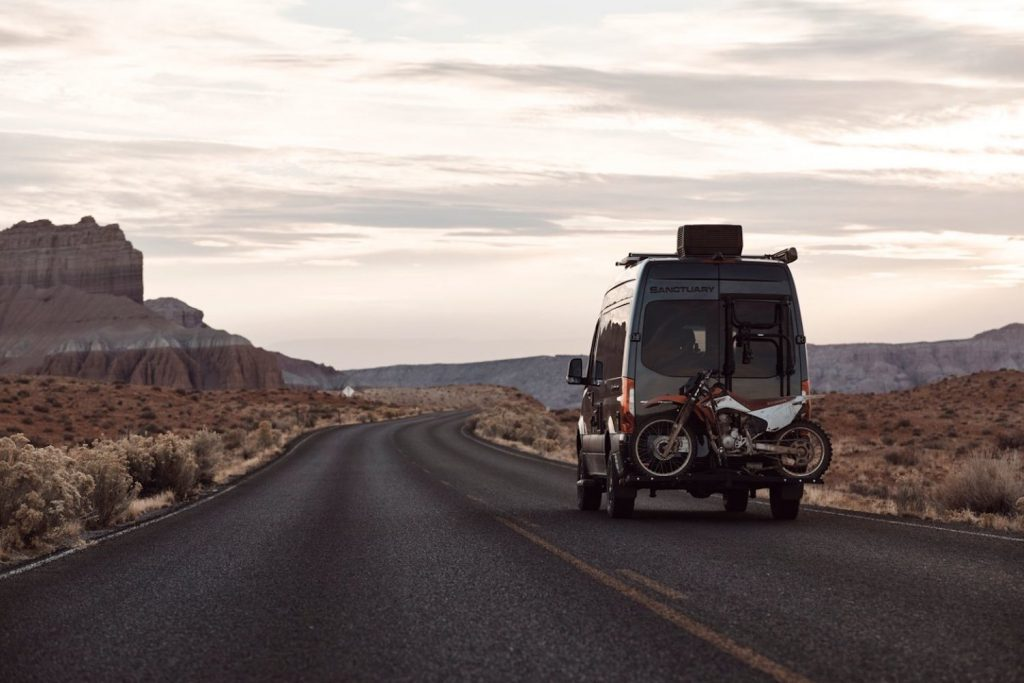 Thor 4x4 Sanctuary camper van  with a dirtbike on the back