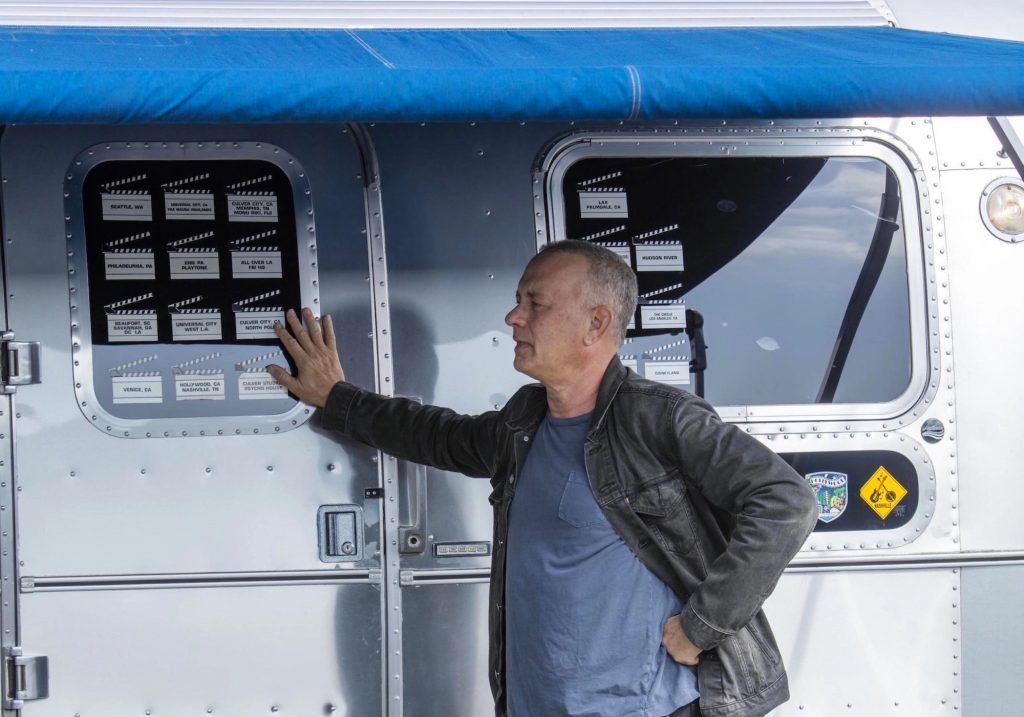 Tom Hanks standing with his Airstream Model 34
