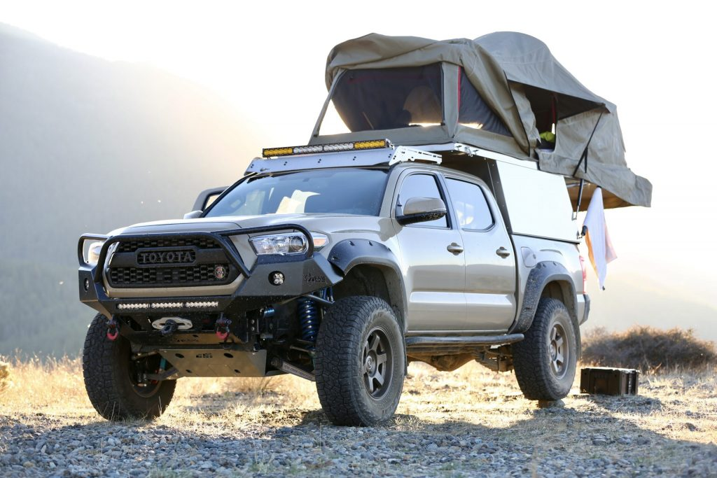 2017 Toyota Tacoma overlanding rig with roof tent set up on top