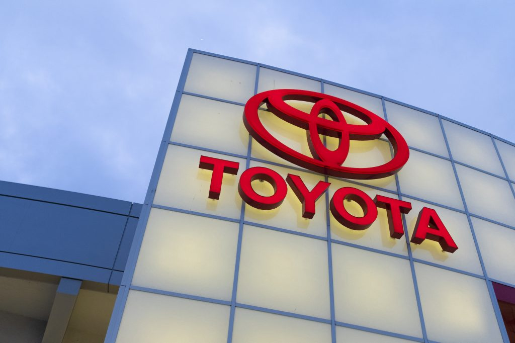 A lighted red Toyota logo on a car dealership in San Jose, California, in November 2019