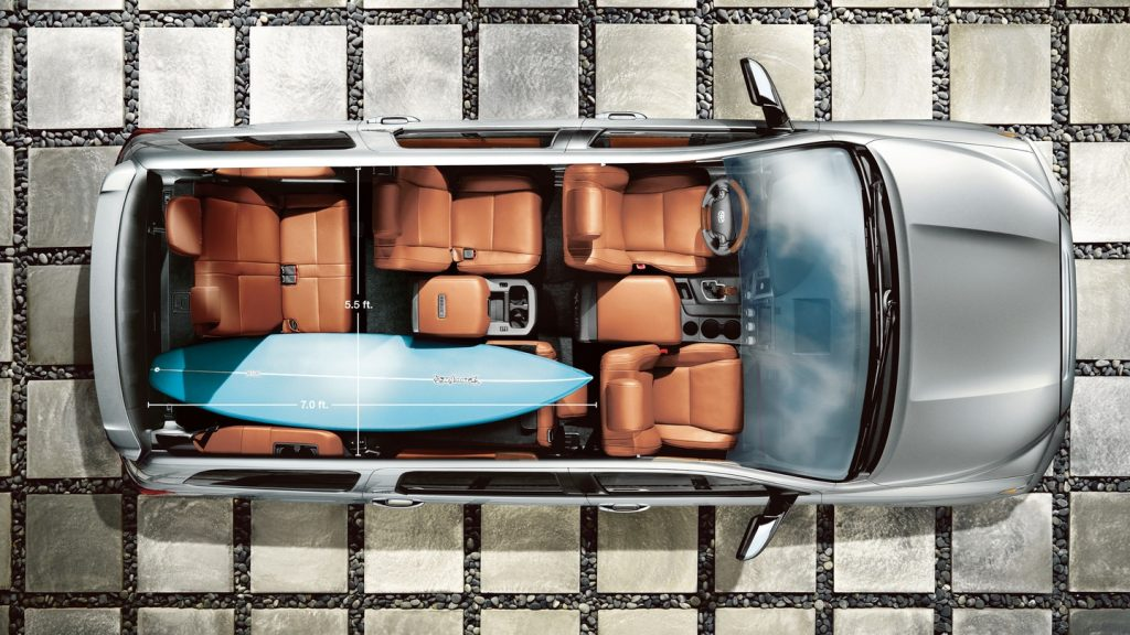 interior view of the biggest toyota SUV the sequoia from above with a surf board in the back