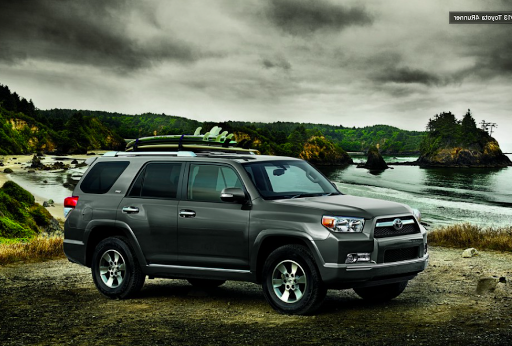 2013 Toyota 4Runner outside with surfboards on top