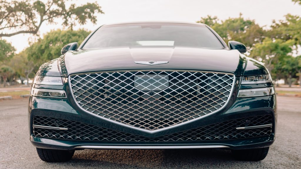 An image of a 2021 Genesis G80 parked outdoors.