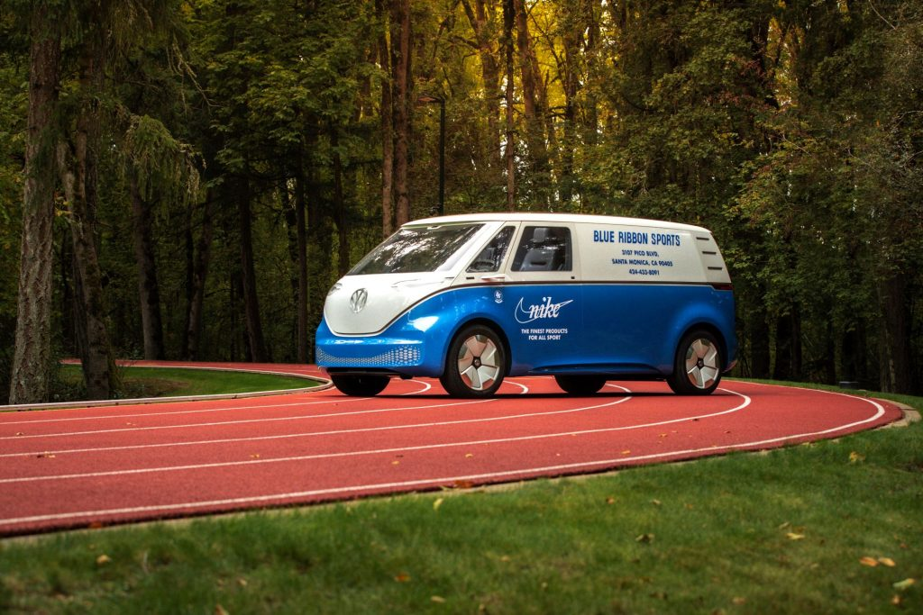 A Volkswagen ID. Buzz model with Nike and Blue Ribbon branding parked on a running track