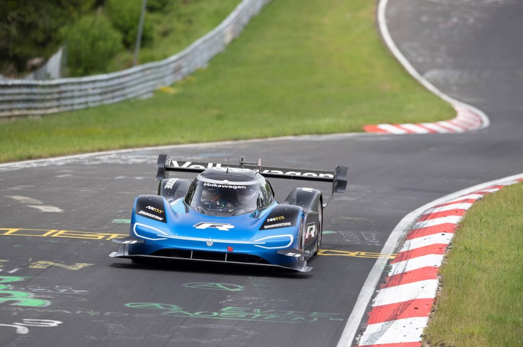 The Volkswagen ID. R electric race car driving on a race track