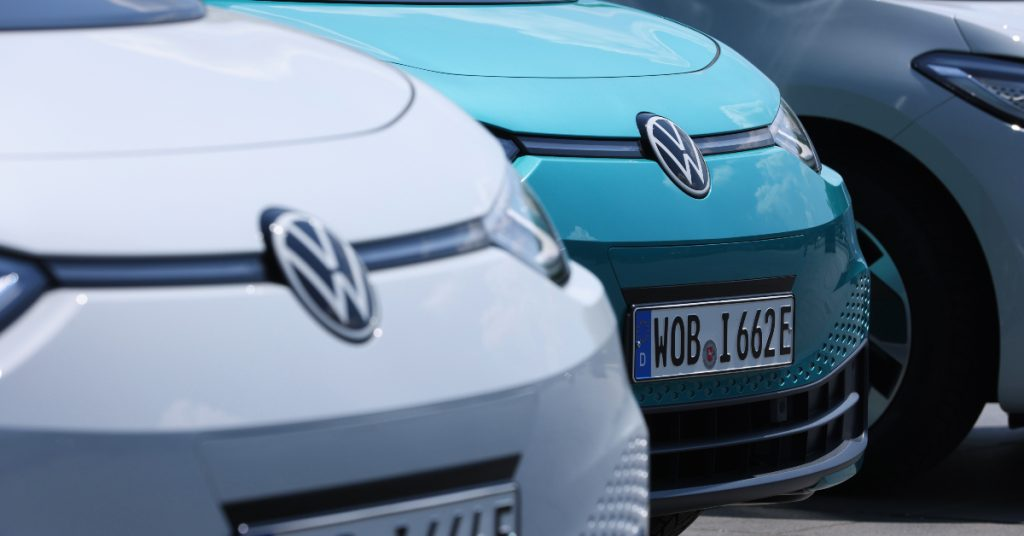 "Volkswagen ID.3 electric cars stand on display outside the ""Gläserne Manufaktur""."