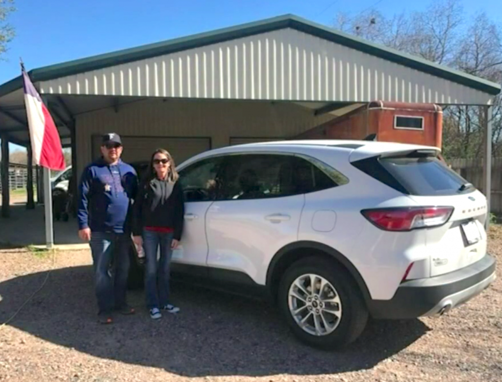 Walker with her new Ford Escape in better times